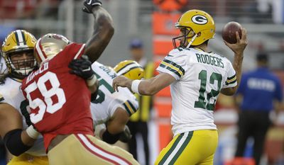 Green Bay Packers quarterback Aaron Rodgers, right, drops back to throw as San Francisco 49ers outside linebacker Eli Harold, left, closes in during the first half of an NFL preseason football game Friday, Aug. 26, 2016, in Santa Clara, Calif. (AP Photo/Ben Margot)