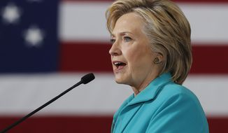 Democratic nominee Hillary Clinton has said she would cap day care expenses at 10 percent of a family's income and increase wages for industry workers to prevent high turnover rates. (Associated Press)