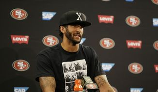 San Francisco 49ers quarterback Colin Kaepernick sat on the bench during Friday's national anthem at Levi's Stadium, a decision he told NFL Media is based on the United States oppressing African-Americans and other minorities. (Associated Press)