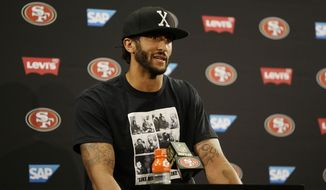 San Francisco 49ers quarterback Colin Kaepernick sat on the bench during Friday's national anthem at Levi's Stadium, a decision he told NFL Media is based on the United States oppressing African Americans and other minorities. (Associated Press)