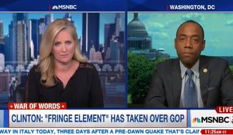 """MSNBC host Alex Witt cued up Cornell William Brooks for a clip of Hillary Clinton speech on Donald Trump and the so-called alt-right. But what played, according to clips posted on Mediate and elsewhere, was a commercial for KFC in which a dark-toned George Hamilton plays the """"Extra Crispy Colonel"""" tanning his flesh on the beach. (MSNBC)"""