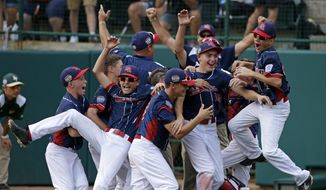 Endwell, N.Y. celebrates its win over South Korea in the Little League World Series Championship baseball game in South Williamsport, Pa., Sunday, Aug. 28, 2016. (AP Photo/Gene J. Puskar)