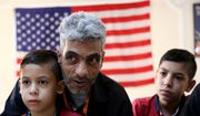 In this photo taken Sunday, Aug. 28, 2016, Syrian refugee Nadim Fawzi Jouriyeh, 49, speaks to reporters at the Amman, Jordan, office of the International Organization for Migration. Jouriyeh is flanked by his sons Farouq, 8, and Hamzeh, 12. The six-member Jouriyeh family will head to San Diego, California, as part of a year-long program to resettle 10,000 Syrian refugees in the United States. (AP Photo/Raad Adayleh)