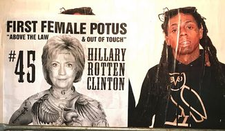 """The street artist known as Sabo covered Los Angeles with a piece on Hillary Clinton titled """"Above the Law & Out of Touch."""" (Twitter, Unsavoryagents)"""