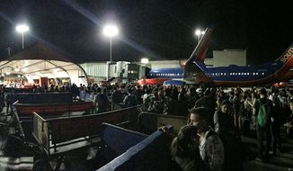 Hundreds of people were evaciuated onto the runway at Los Angeles International Airport on Sunday night amid reports of an active shooter (Twitter / @rossegreenberg)