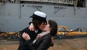 Petty Officer 2nd Class Marissa Gaeta, left, kisses her girlfriend, Petty Officer 3rd Class Citlalic Snell at Joint Expeditionary Base Little Creek in Virginia Beach, Va. on Wednesday, Dec. 21, 2011.