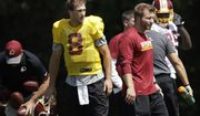 Washington Redskins starting quarterback Kirk Cousins (8) walks on the field during practice at the team's NFL football training facility at Redskins Park in Ashburn, Va., Monday, Aug. 29, 2016. (AP Photo/Manuel Balce Ceneta)