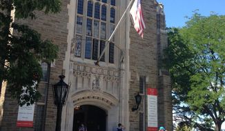 Students walk from Willard Straight Hall on the Cornell University campus in Ithaca, N.Y., Monday, Aug. 29, 2016. (AP Photo/Carolyn Thompson) ** FILE **