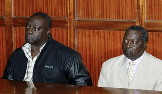 National Olympic Committee of Kenya secretary general Francis K Paul, left, and vice-chairman Pius Ochieng, right, appear at the High Court in Nairobi, Kenya, Monday, Aug. 29, 2016, following their arrest last week on their return from Brazil. Three senior Kenyan Olympic committee officials are the subjects of a criminal investigation relating to alleged theft and abuse of office during this month's Rio de Janeiro Olympic Games, with Ochieng and Paul being granted bail, while Kenya team leader Stephen Arap Soi was absent from court for medical reasons. (AP Photo/Khalil Senosi)