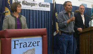 Fort Peck tribal chairman Floyd Azure, center, introduces U.S. Rep. Ryan Zinke and Democratic challenger Denise Juneau, left, in their first debate on Monday, Aug. 29, 2016, in Frazer, Mont. Denise Juneau, the outgoing state superintendent of public instruction, is trying to unseat the first-term congressman in November's election. (AP Photo/Richard Peterson)