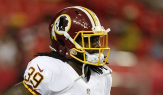 Washington Redskins running back Keith Marshall (39) warms up before the first half of a preseason NFL football game against the Atlanta Falcons, Thursday, Aug. 11, 2016, in Atlanta. (AP Photo/Brynn Anderson)