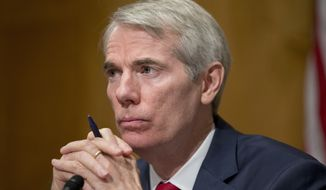 FILE - In this June 23, 2016 file photo, Sen. Rob Portman, R-Ohio listens during a hearing on Capitol Hill in Washington. Major national Democratic political groups are canceling ad spending in the Ohio Senate race as Democratic former Gov. Ted Strickland fails to get traction against incumbent Republican Sen. Rob Portman in the critical swing state.  (AP Photo/Alex Brandon, File)