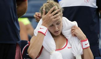 FILE - In this Sept. 4, 2015, file photo, Eugenie Bouchard, of Canada, takes a break between games against Dominika Cibulkova, of Slovakia, at the U.S. Open tennis tournament in New York. Bouchard won that match. Bouchard fell at the facility and suffered a concussion, and withdrew before her fourth-round match. Bouchard missed most of the rest of the season. She filed suit against the U.S. Tennis Association in U.S. District Court in Brooklyn in October, and that case is still pending, putting the 2014 Wimbledon runner-up in the odd position of competing this week at an event whose organizers she is suing. (AP Photo/Charles Krupa, File) **FILE**