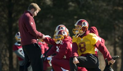 Sean McVay (left) is entering his third season as the Washington Redskins' offensive coordinator. And at 30 years old, McVay is the youngest in the NFL to hold that position. The Redskins players and staff have taken notice to McVay's poise and sense of accountability which have guided him through a rapid ascension within the coaching ranks. (Associated Press)