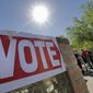 Voters wait in line to cast their ballot in Arizona's presidential primary election earlier this year. (Associated Press)