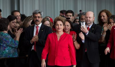 """Ousted President Dilma Rousseff took to Twitter to voice her outrage with her impeachment, saying that the courts """"threw 54 million Brazilian votes in the garbage."""" (Associated Press)"""