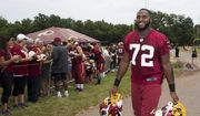 Washington Redskins defensive end Anthony Lanier (72) carries helmets as he walks from the field during the NFL football teams minicamp at the Redskins Park in Ashburn, Va., Wednesday, June 15, 2016. (AP Photo/Manuel Balce Ceneta)