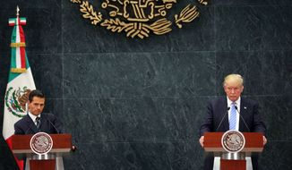 Republican presidential candidate Donald Trump, right, and Mexico's President Enrique Pena Nieto, listen to a reporter's question during a joint statement at Los Pinos, the presidential official residence, in Mexico City, Wednesday, Aug. 31, 2016. Trump is calling his surprise visit to Mexico City Wednesday a 'great honor.'  The Republican presidential nominee said after meeting with Peña Nieto that the pair had a substantive, direct and constructive exchange of ideas.(AP Photo/Dario Lopez-Mills)