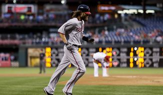 Washington Nationals' Jayson Werth, left, rounds the bases after hitting a home run off Philadelphia Phillies starting pitcher Adam Morgan, right, during the first inning of a baseball game Wednesday, Aug. 31, 2016, in Philadelphia. (AP Photo/Matt Slocum)