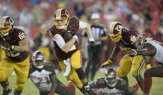 Washington Redskins quarterback Nate Sudfeld (2) gains yards as he scrambles against the Tampa Bay Buccaneers during the 3rd quarter of an NFL football game Wednesday, Aug.31,2016, in Tampa, Fla. (AP Photo/Jason Behnken