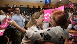 Rep. Debbie Wasserman Schultz, D-Fla., left, arrives for an event with supporters on primary election night, Tuesday, Aug. 30, 2016, in Sunrise, Fla. (AP Photo/Lynne Sladky)