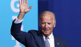 Vice President Joseph R. Biden on Thursday touted the qualifications of Democratic presidential nominee Hillary Clinton, but refused to defend her family foundation. (Associated Press)