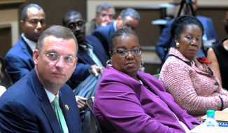Wayne County Prosecutor Kym Worthy (center) discussed community-police relations at the Bipartisan Policing Strategies Working Group in Detroit. (Associated Press)