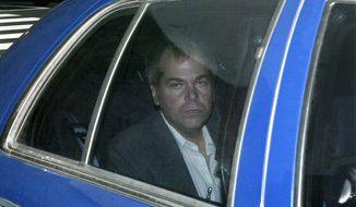 FILE - In this Nov. 18, 2003 file photo, John Hinckley Jr. arrives at U.S. District Court in Washington. The man who shot President Ronald Reagan 35 years ago will leave a psychiatric hospital to live full-time in Virginia on September 10.  (AP Photo/Evan Vucci, File)