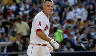 "FILE - In this Tuesday, July 12, 2016 file photo, American League's Mike Trout, of the Los Angeles Angels of Anaheim, talks to the pitcher after striking out during the second inning of the MLB baseball All-Star Game, in San Diego. Trout was not hurt after being involved in a car crash following a game Wednesday night, Aug. 31, 2016. Trout did not play in Los Angeles' 3-0 win over the Cincinnati Reds. Angels general manager Billy Eppler confirmed the crash and says in a statement he's spoken to Trout and ""he feels fine."" Eppler says Trout was at home and is planning to travel with the club Thursday to Seattle. (AP Photo/Lenny Ignelzi, File)"