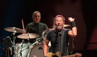 Bruce Springsteen backed up by E Street Band drummer Max Weinberg at Nationals Park.  (Erica Bruce)