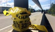 In this July 7, 2016 photo, police tape hangs from a hand rail near where two people were killed on the Ship Creek Trail in downtown Anchorage, Alaska. The double homicide is among nine unsolved cases this year in which people have been found dead in Anchorage parks, trails and on isolated streets. (AP Photo/Mark Thiessen)
