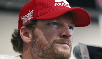In this Aug. 5, 2016, photo, Dale Earnhardt Jr. listens to a question about his concussion while addressing the media at Watkins Glen International racetrack in Watkins Glen, N.Y. Earnhardt will miss the rest of the NASCAR season as he continues to recover from a concussion. (AP Photo/Mel Evans, File)