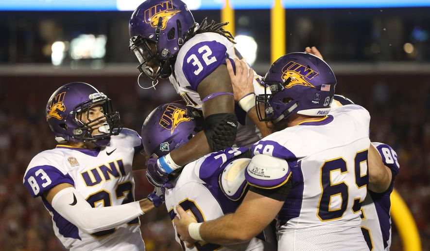 Northern Iowa running back Tyvis Smith is hoisted into the air by his teammates after scoring a touchdown during the first half of an NCAA college football game against Iowa State, Saturday, Sept. 3, 2016, in Ames, Iowa. (AP Photo/Justin Hayworth)
