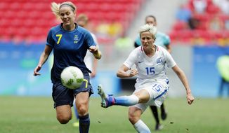 "In this Friday, Aug. 12, 2016, file photo, United States' Megan Rapinoe, right, kicks the ball past Sweden's Lisa Dahlkvist during a quarterfinal match of the women's Olympic soccer tournament in Brasilia. Rapinoe knelt during the national anthem Sunday, Sept. 4, before the Seattle Reign's game against the Chicago Red Stars ""in a little nod"" to NFL quarterback Colin Kaepernick. (AP Photo/Eraldo Peres, File)"