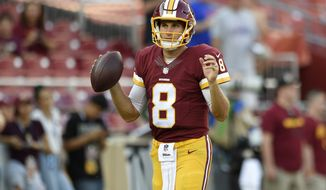 Washington Redskins quarterback Kirk Cousins warms up before an NFL preseason football game against the Buffalo Bills, Friday, Aug. 26, 2016, in Landover, Md. (AP Photo/Nick Wass)