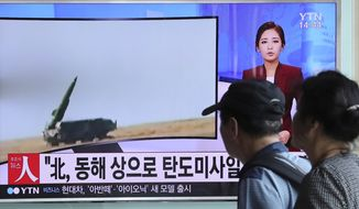 """People watch a TV news program reporting about North Korea's missile launch, at the Seoul Train Station in Seoul, South Korea, Monday, Sept. 5, 2016. North Korea fired three ballistic missiles off its east coast Monday, South Korea's military said, in a show of force timed to the G-20 economic summit in China. The letters on the screen read: """"North Korea, ballistic missiles to east coast."""" (AP Photo/Lee Jin-man)"""