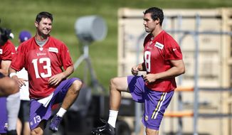 Minnesota Vikings quarterbacks Shaun Hill, left, and Sam Bradford warm up during practice Monday Sept. 5, 2016, in Eden Prairie, Minn. The Philadelphia Eagles traded Bradford to the Vikings on Saturday, for a pair of draft picks. (Jerry Holt/Star Tribune via AP)