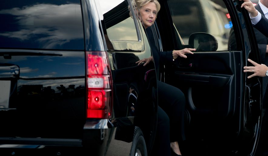 Democratic presidential candidate Hillary Clinton arrives at her campaign plane at Tampa International Airport in Tampa, Tuesday, Sept. 6, 2016, to fly to Westchester, N.Y., after speaking at a rally. (AP Photo/Andrew Harnik)
