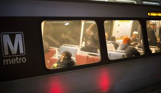 In this Nov. 16, 2015, file photo, passengers ride a Washington Metro subway train at the Chinatown Metro Station in Washington. (AP Photo/Pablo Martinez Monsivais) ** FILE **