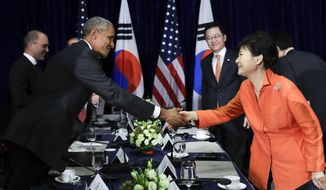 U.S. President Barack Obama, left,  and South Korean President Park Geun-hye shake hands after speaking to the media at the conclusion of a bilateral meeting in Vientiane, Laos, Tuesday, Sept. 6, 2016. (AP Photo/Carolyn Kaster) ** FILE **