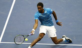 Gael Monfils, of France, returns a shot to Lucas Pouille, of France, during the quarterfinals of the U.S. Open tennis tournament, Tuesday, Sept. 6, 2016, in New York. (AP Photo/Kathy Willens)