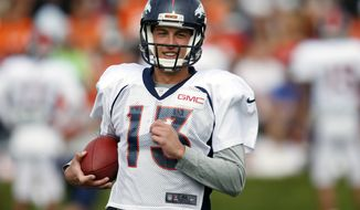 FILE - In this Aug. 4, 2016, file photo, Denver Broncos quarterback Trevor Siemian takes part in drills during the team's NFL football training camp in Englewood, Colo. The Carolina Panthers are out to rattle Siemian Thursday night, Sept. 8, in his first start for the Super Bowl champion Broncos. Thing is, his teammates say they've never seen the strong-armed, mobile QB lose his cool.  (AP Photo/David Zalubowski, File)
