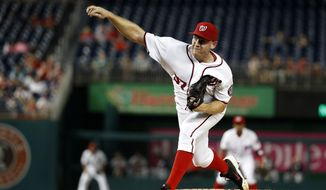 Washington Nationals starting pitcher Stephen Strasburg throws during the first inning of a baseball game against the Atlanta Braves at Nationals Park, Wednesday, Sept. 7, 2016, in Washington. (AP Photo/Alex Brandon)
