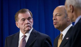 Former Homeland Security Secretary Tom Ridge (left) listens as current Homeland Security Secretary Jeh Johnson speaks during a news conference in Washington on Feb. 25, 2015. At right is former Homeland Security Secretary Michael Chertoff. (Associated Press) **FILE**