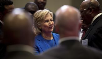 Democratic presidential candidate Hillary Clinton winks at a man as she greets members of the audience after speaking at the 136th Annual National Baptist Convention held at the Kansas City Convention Center, in Kansas City, Mo., Thursday, Sept. 8, 2016. (AP Photo/Andrew Harnik)