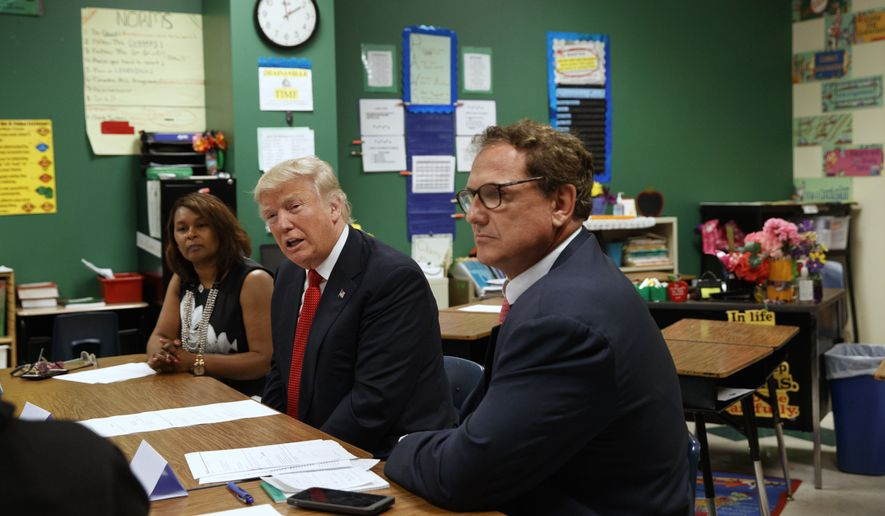 Republican presidential candidate Donald Trump meets with students and educators before speaking about school choice, Thursday, Sept. 8, 2016, at Cleveland Arts and Social Sciences Academy in Cleveland. (AP Photo/Evan Vucci)
