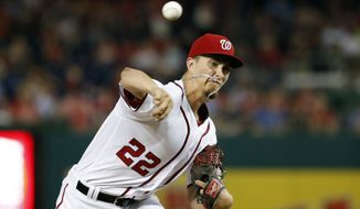 Washington Nationals pitcher A.J. Cole throws during the third inning of a baseball game against the Philadelphia Phillies at Nationals Park, Thursday, Sept. 8, 2016, in Washington. (AP Photo/Alex Brandon)