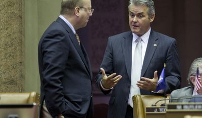 Assemblyman Bill Nojay, R-Pittsford, left, and Assemblyman Steve McLaughlin, R-Troy, talk in the Assembly Chamber at the Capitol on Tuesday, March 1, 2016, in Albany, N.Y. (AP Photo/Mike Groll)