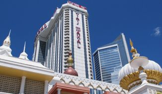 This April 24, 2015, file photo, shows the exterior of the Trump Taj Mahal casino in Atlantic City, N.J. (AP Photo/Wayne Parry, File)