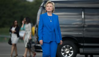 Democratic presidential candidate Hillary Clinton arrives to speak to members of the media before boarding her campaign plane at Westchester County Airport, in White Plains, N.Y., Thursday, Sept. 8, 2016, to travel to Charlotte, N.C., to attend a campaign rally. (AP Photo/Andrew Harnik)